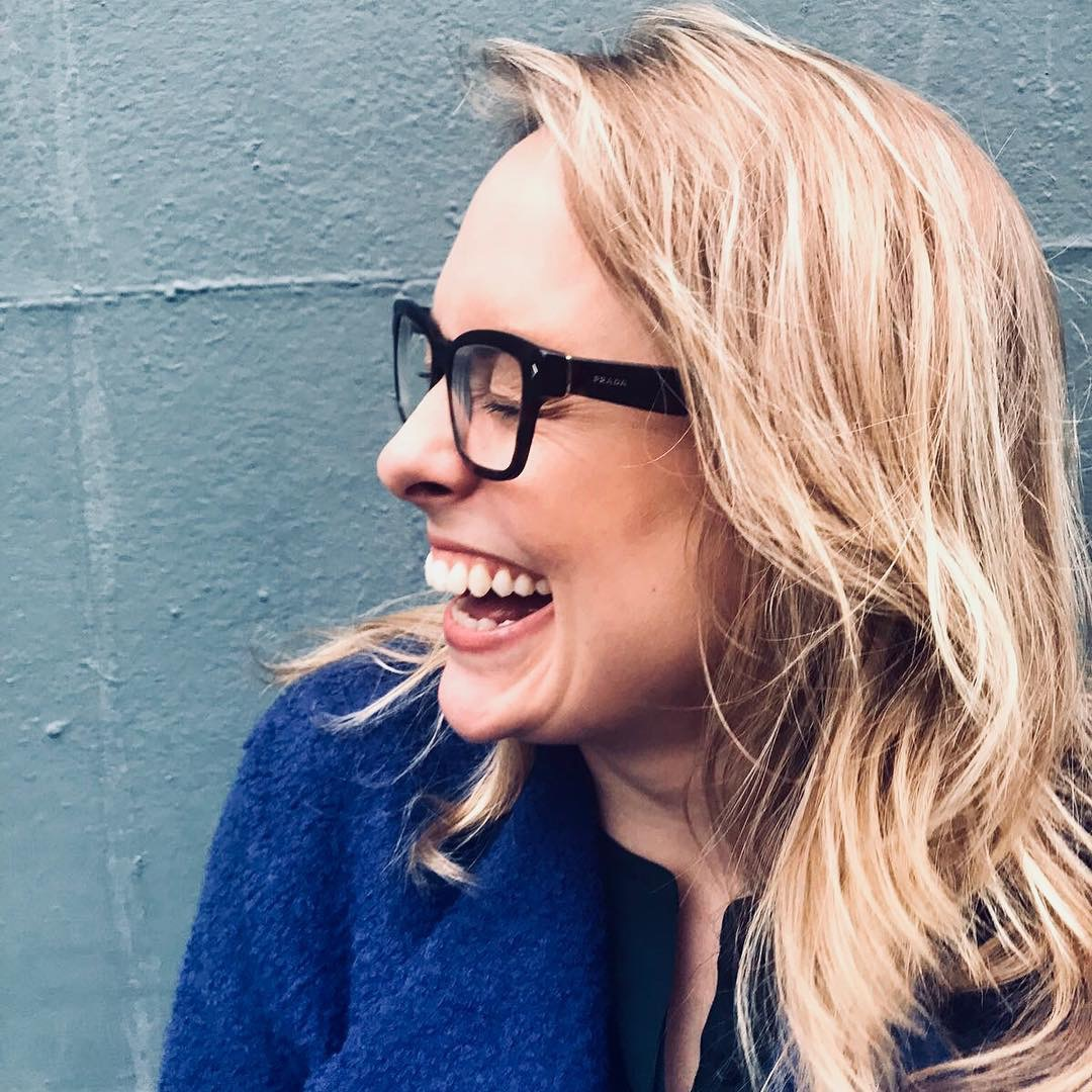 Natasha Bailie mental mutha blonde woman with glasses laughing happy