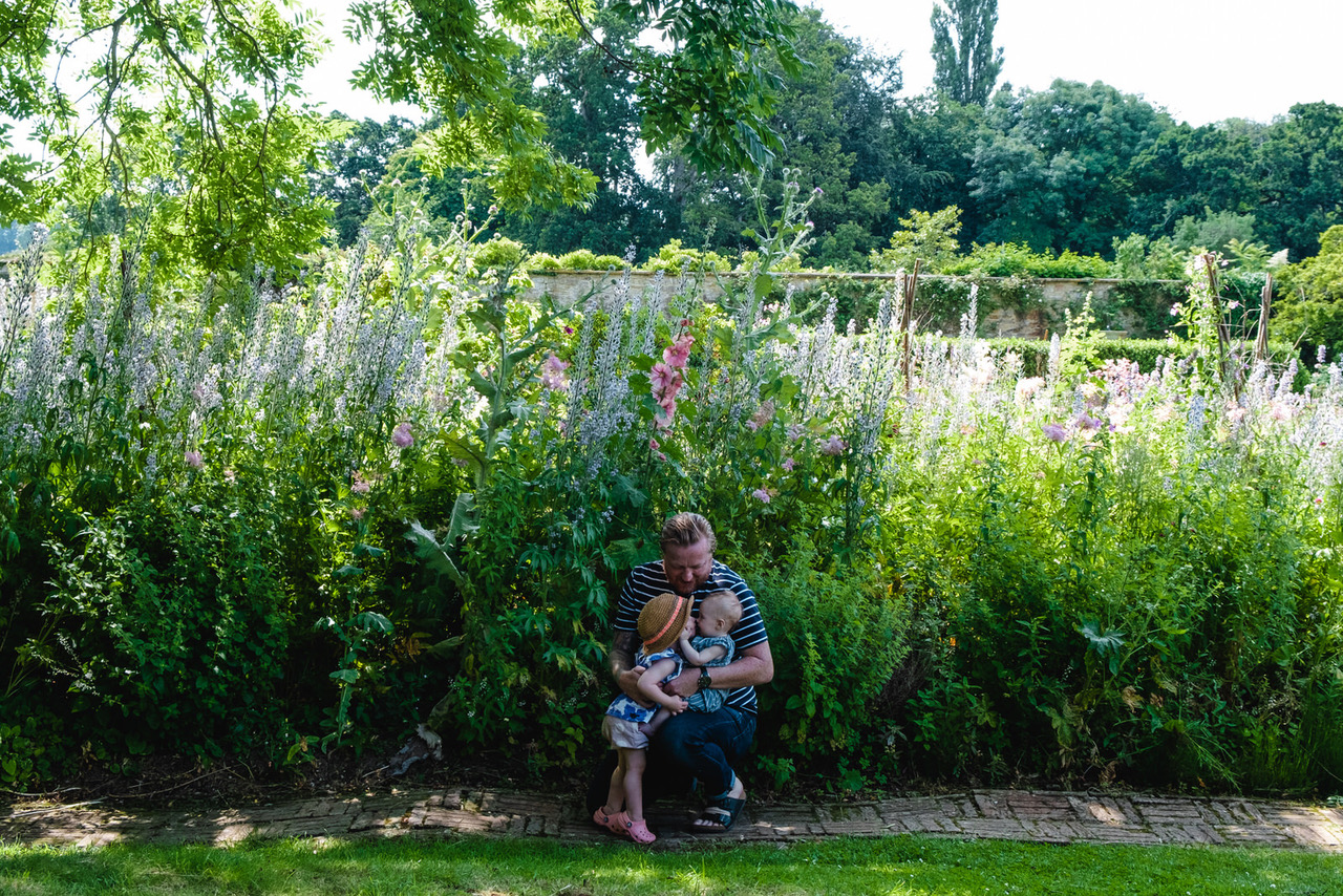 parenthood example, father with his two daughters at Barrington Court somerset in flower gardens family photo