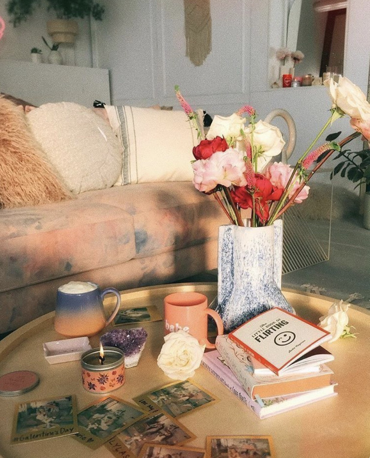 stylish, boho, lived-in living room with flowers